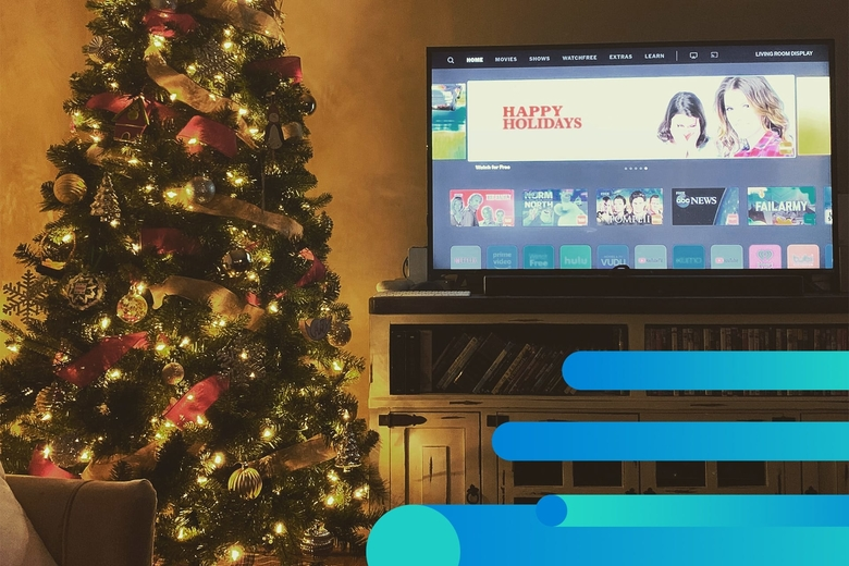 Netflix streaming screen in a living room decorated with a tree for Christmas