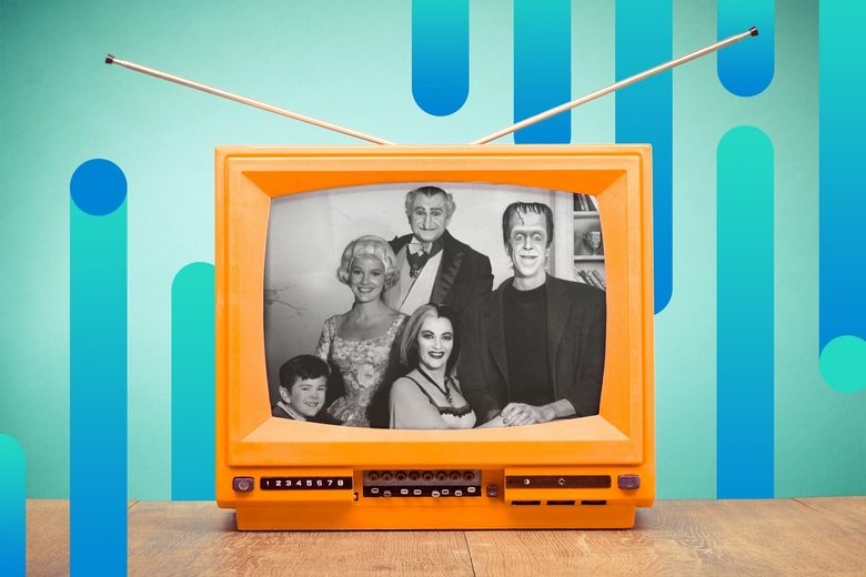A promotional photo of The Munsters tv show displays on the screen of a tube television