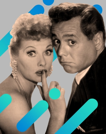 Lucille Ball and Desi Arnaz pose for a promotional photo produced for the I Love Lucy tv show