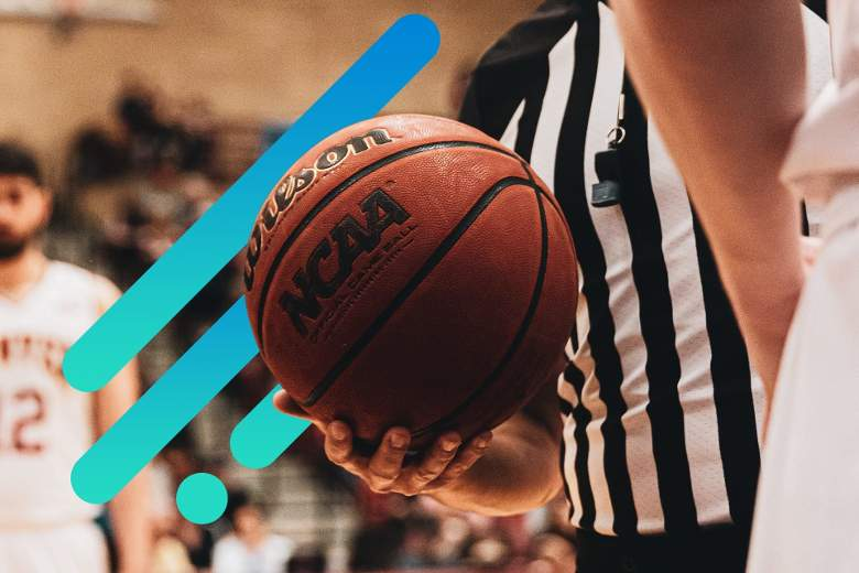 Photo of a referee holding an NCAA regulation basketball at waist height, with Suddenlink graphic overlays