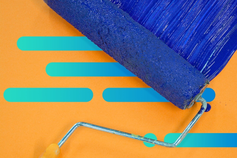 Paint roller over an abstract orange background with blue paint