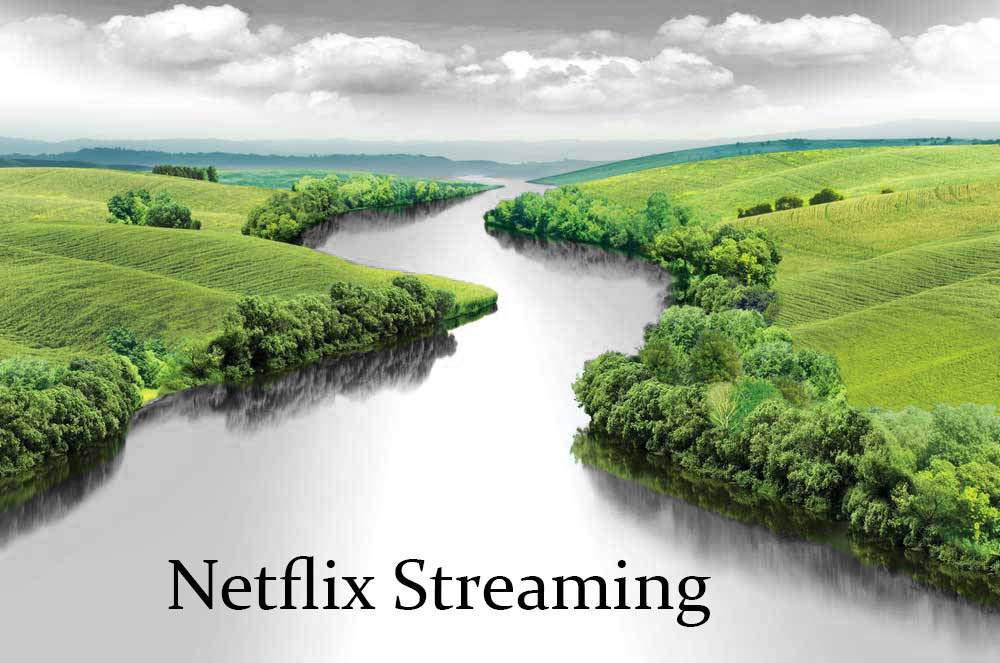 """Green grass with gray river with black text overlay that reads """"Netflix Streaming."""""""