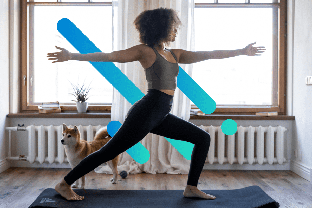 woman doing a home workout on a yoga mat with blue stripe background
