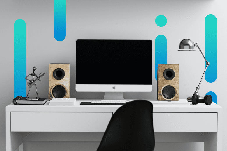 iMac with a home sound system with abstract background