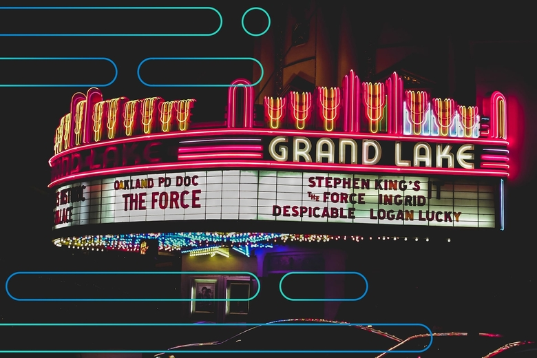 Exterior of cinema with movie listing sign with abstract overlay